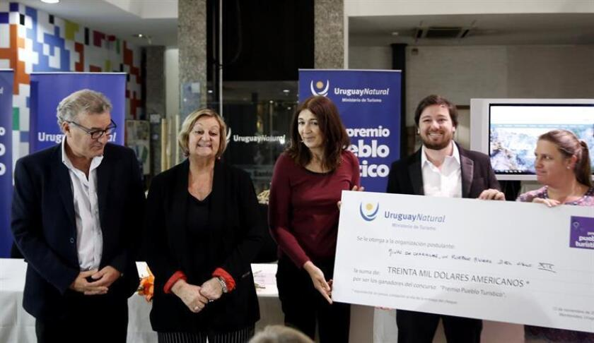 MONTEVIDEO (URUGUAY), Nov. 12, 2018: (L-R) Uruguay's national director of tourism, Carlos Fagetti, Uruguay's minister of tourism, Liliam Kechichian; Uruguay's general director of the Minister of Tourism, Hyara Rodríguez and the winners of the 2018 Tourist Town Award pose during the ceremony that awarded the town of Minas de Corrales for its proposal to show visitors the history of mining activity in the area. EPA/EFE/Alejandro Prieto
