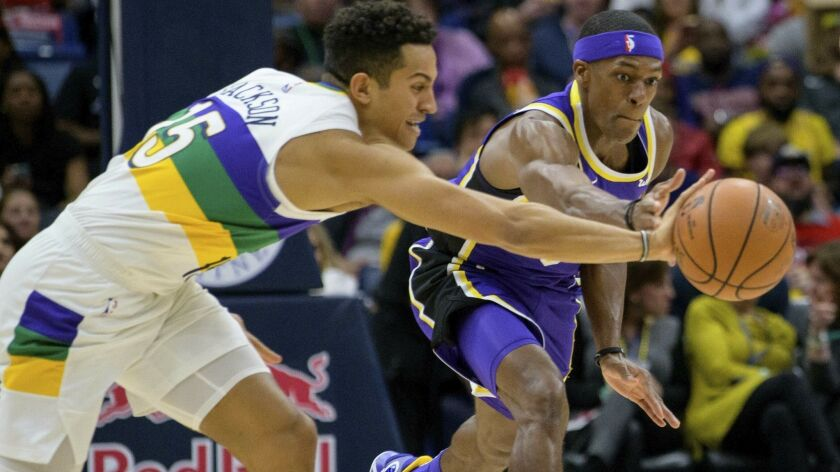 New Orleans Pelicans guard Frank Jackson (15) and Los Angeles Lakers guard Rajon Rondo (9) reach for