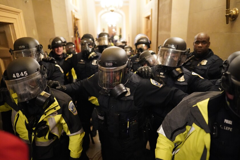 Riot police clear the hallway inside the Capitol on Wednesday, Jan. 6, 2021 in Washington, DC.