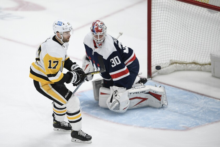 Pittsburgh Penguins right wing Bryan Rust (17) skates by after he scored a goal against Washington Capitals goaltender Ilya Samsonov (30) during the first period of an NHL hockey game Saturday, May 1, 2021, in Washington. (AP Photo/Nick Wass)