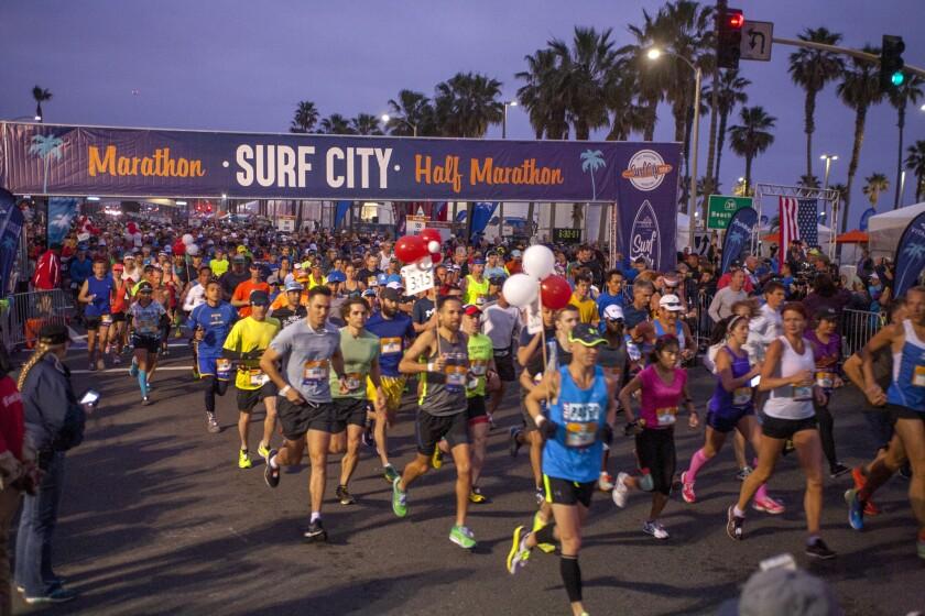 Surf City Marathon contestants begin the 2017 race in Huntington Beach. This year's marathon on Sunday will highlight three days of events.