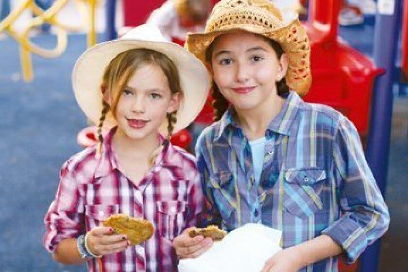 Second graders Sofia Burity and Isabel Reynoso enjoy dessert. Courtesy photos