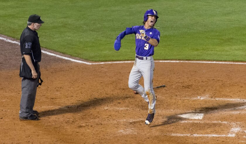 LSU's Kramer Robertson (3) celebrates after scoring to give the team the lead over Florida during the eighth inning of a Southeastern Conference baseball tournament game Wednesday, May 25, 2016, in Hoover, Ala. (Vasha Hunt/AL.com via AP)