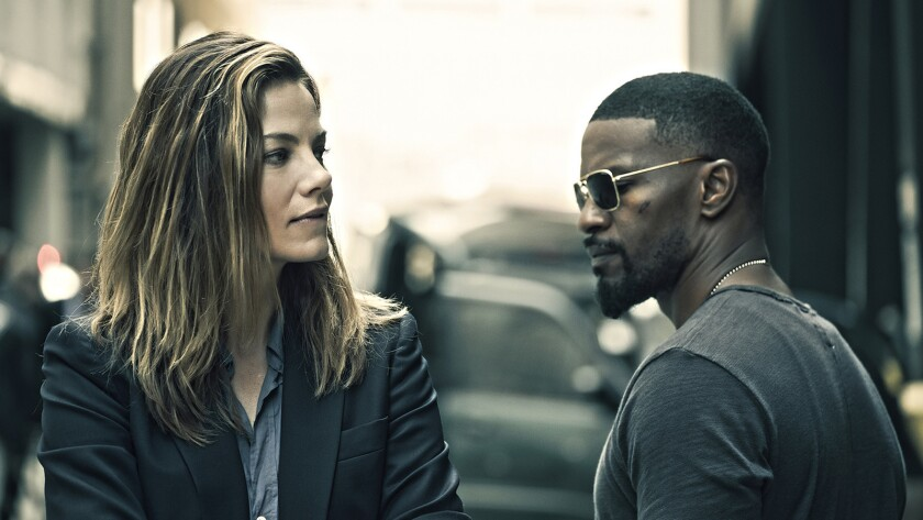 """Michelle Monaghan and Jamie Foxx in """"Sleepless."""""""