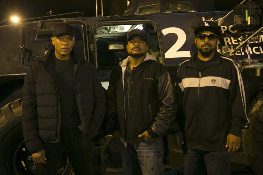 """Producer Dr. Dre, left, director/producer F. Gary Gray and producer Ice Cube on the set of """"Straight Outta Compton."""""""