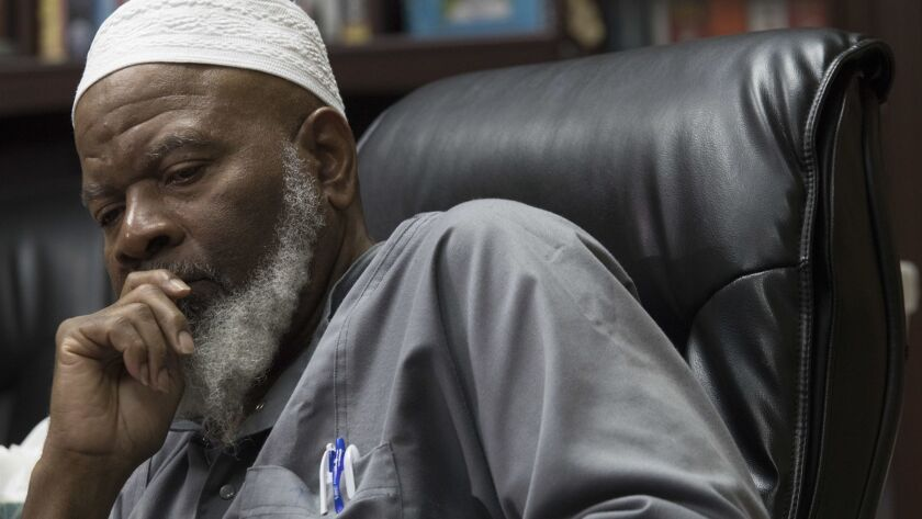 Imam Siraj Wahhaj, the grandfather of a missing Georgia boy, speaks to reporters Thursday.