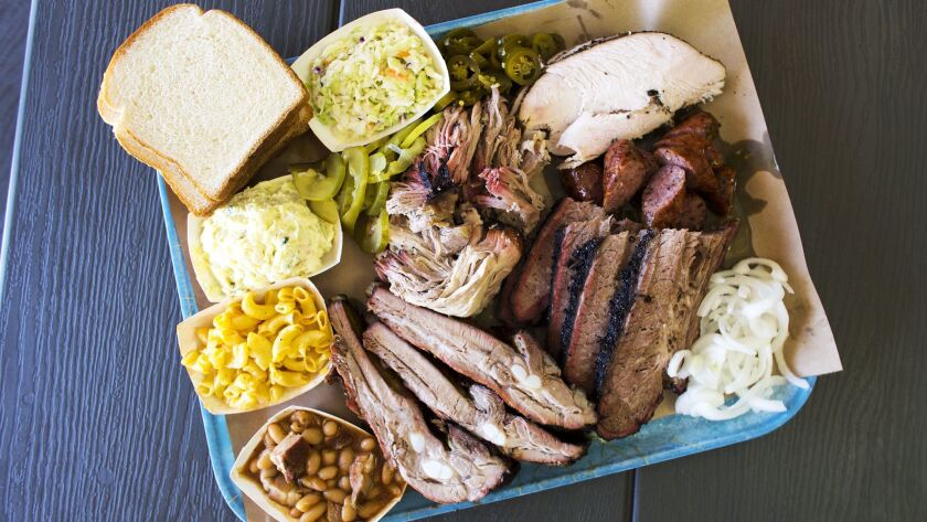 A smorgasbord of items from the menu at Ray's BBQ includes pork ribs, beef brisket, pulled pork, tur