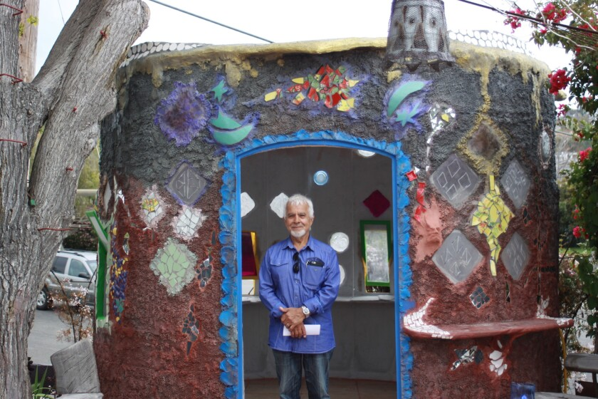 Artist Nasser Pirasteh in front of the installation titled 'In-Out' in his front yard that the City says must be moved by Nov. 5.