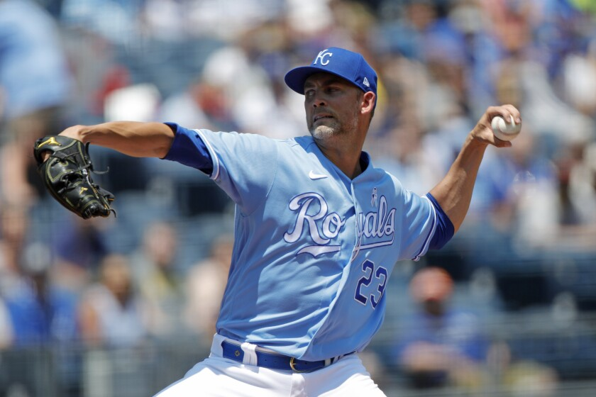 Kansas City Royals pitcher Mike Minor throws to a batter during the first inning of a baseball game against the Boston Red Sox at Kauffman Stadium in Kansas City, Mo., Sunday, June 20, 2021. (AP Photo/Colin E. Braley)