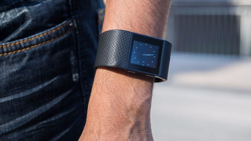 Google is venturing back into the very crowded field of fitness-tracking devices.