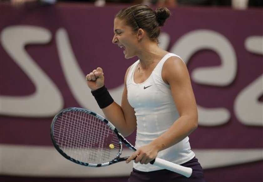 Sara Errani of Italy reacts during the final match against Mona Barthel of Germany at the 21st Gaz de France WTA Open 2013 tennis tournament at Coubertin stadium, in Paris, Sunday, Feb. 3, 2013. (AP Photo/Francois Mori)