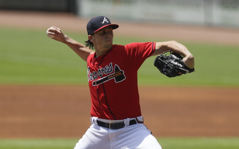 Atlanta Braves starting pitcher Kyle Wright delivers in the first inning of a baseball game against the New York Mets, Sunday, Aug. 2, 2020, in Atlanta. (AP Photo/Brynn Anderson)