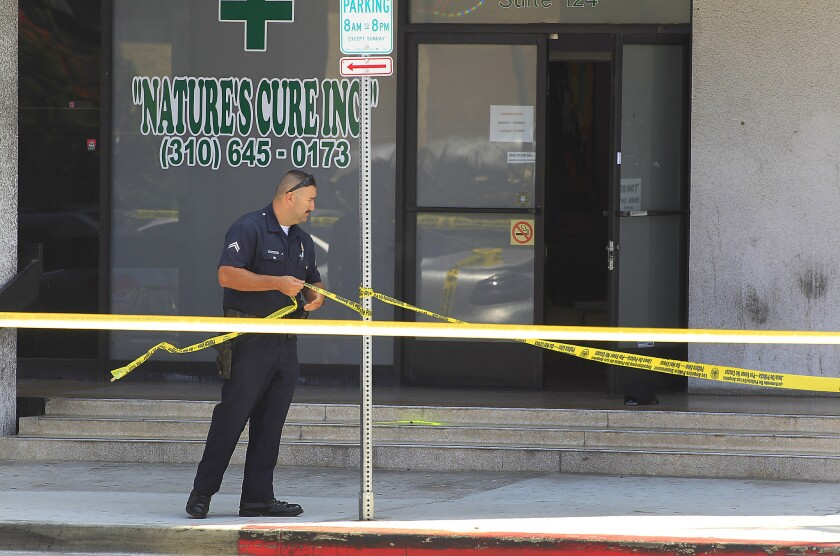 Police investigate a shooting at 5300 W. Century Boulevard near LAX. The shooting occurred during an attempted robbery of a medical marijuana dispensary.