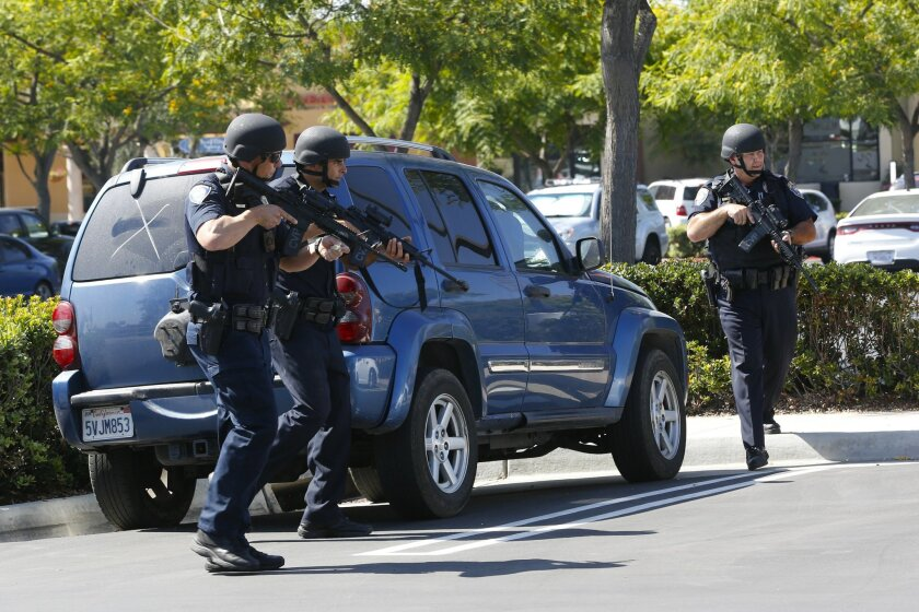 Task force agents shoot suspect, arrest 2 others and leads Chula Vista Police officers to search vehicles in the shopping center of San Miguel Ranch in Chula Vista.