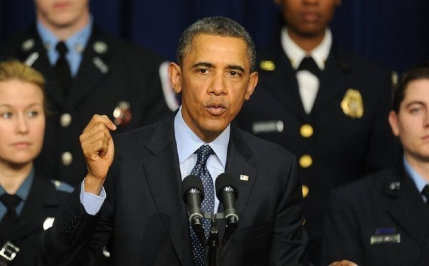 Surrounded by first responders who might be affected by looming budget cuts, President Obama speaks during an event at the Eisenhower Executive Office Building in Washington.