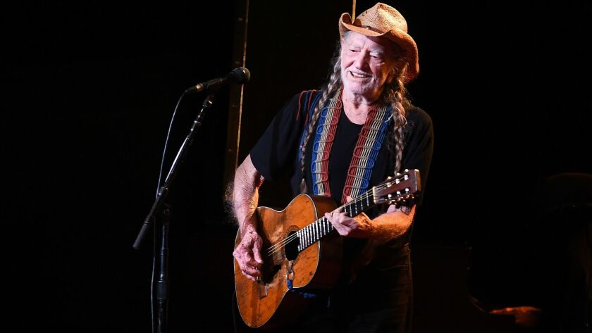 Willie Nelson, shown at the Shrine Auditorium in 2017, headlines the Outlaw Music Festival coming to the Hollywood Bowl on Oct. 21.