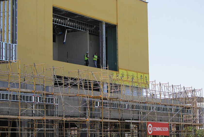 Workers at a partially built Hollywood Target shopping center in August 2014. Weeks earlier, a judge threw out the city's approval of the project, causing work at the site to cease.
