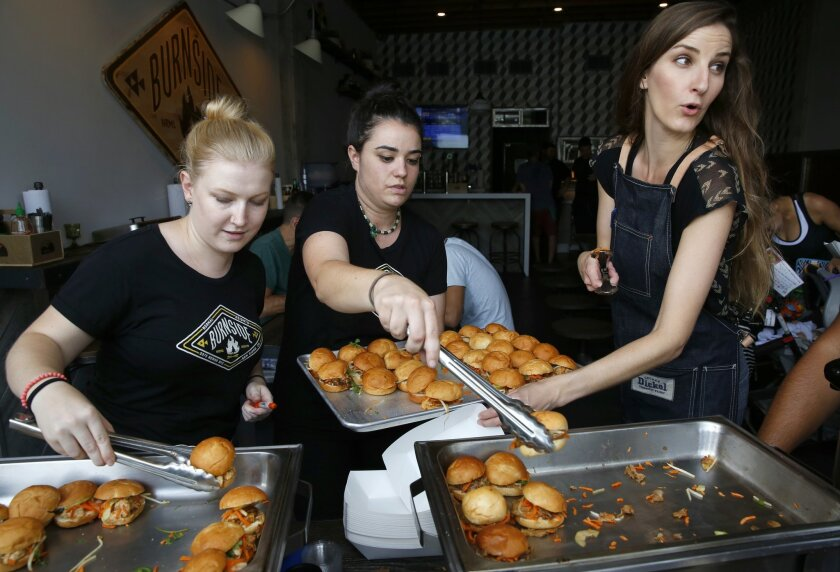 June 28, 2015. San Diego, CA (from Left) Allison Radu, Julia Ennis and Amanda Sprague served up Bahn Mino Sliders (pork and tofu) with hoisin sauce at Burnside in Normal Heights during the 15th annual Taste of Adams Avenue. Nancee E. Lewis / Nancee Lewis Photography. No other reproduction allow wit