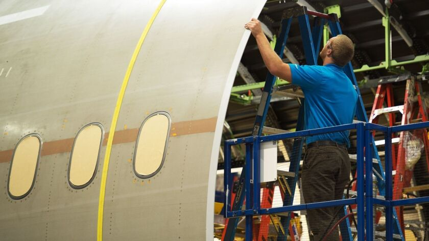 A Boeing employee works on a 787 Dreamliner at the company's factory in South Carolina.