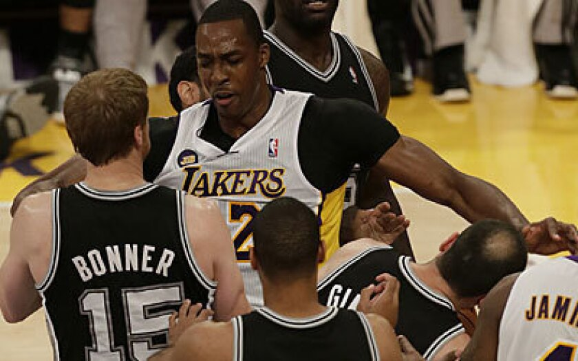 Lakers center Dwight Howard smacks Manu Ginobili of the Spurs, resulting in a technical foul, in the first quarter of Sunday's game.