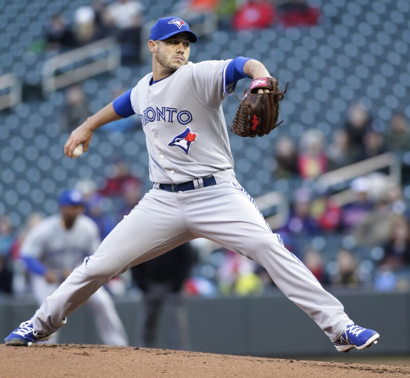 Dustin McGowan, seen here pitching with the Blue Jays last season, agreed to a one-year contract with the Dodgers.
