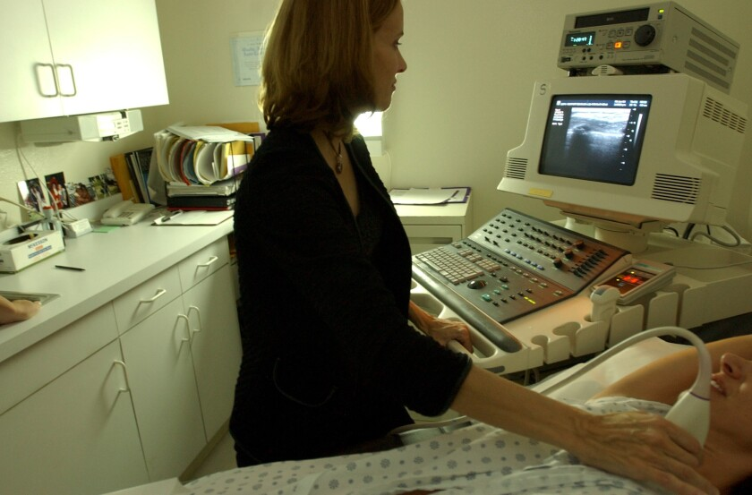National Cancer Institute researchers have forecast an increase of up to 50% in U.S. breast cancer cases between 2011 and 2030. Here, a Los Angeles-area doctor demonstrates how she performs a breast ultrasound.