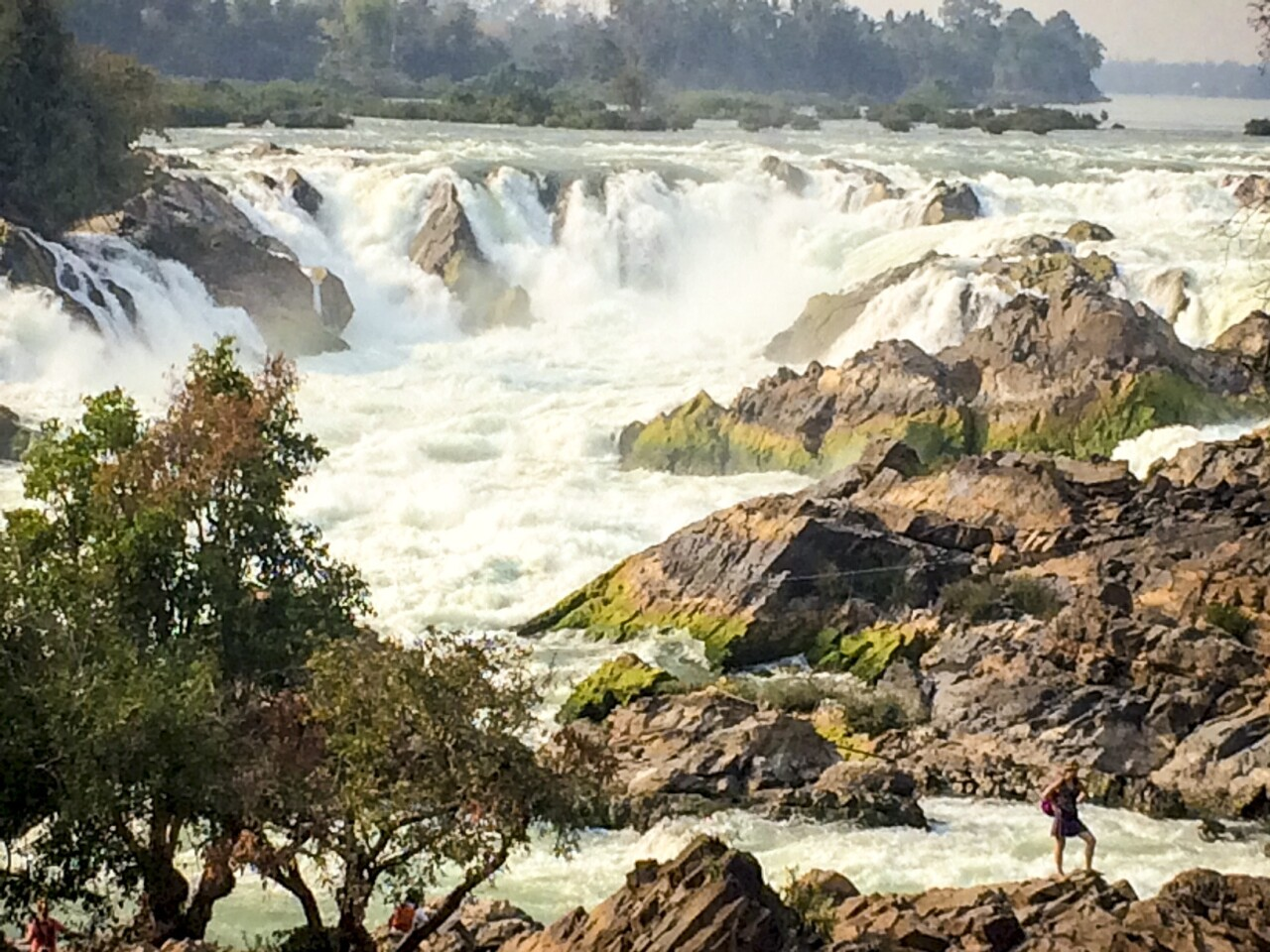 Khone Phapheng in southern Laos is the largest waterfall in Southeast Asia. It is 70 feet high and the confluence of six miles of rapids.