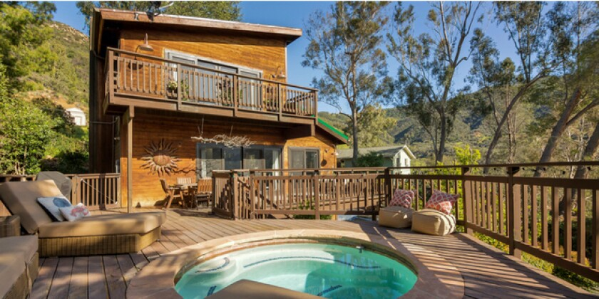Yannick Bisson's mountain retreat opens to a deck with an in-ground spa