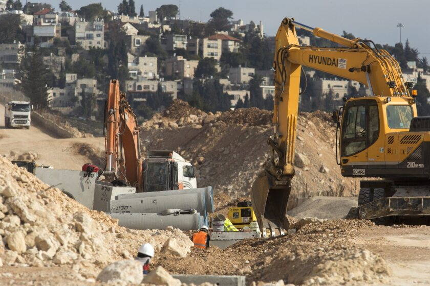 Earth moving equipment in the Ramat Shlomo neighborhood of East Jerusalem on Sunday. It's part of the area captured by Israel during the 1967 Six Day War. Most of the international community considers such neighborhoods to be settlements that violate international law.