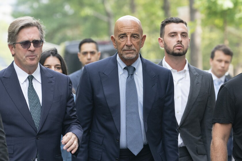 Tom Barrack, center, arrives at Brooklyn federal court, Monday, July 26, 2021, in New York.