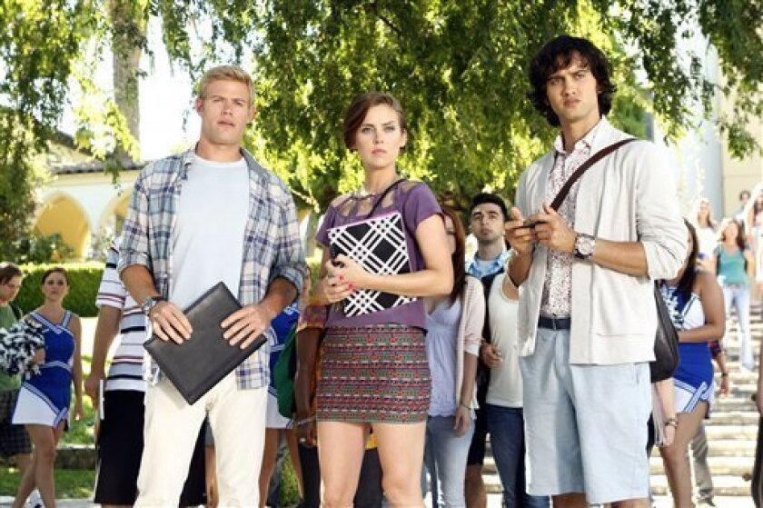 """In this publicity image released by The CW, from left, Trevor Donovan as Teddy, Jessica Stroup as Erin Silver, and Michael Steger as Navid Shirazi are shown in a scene from """"90210"""". (AP Photo/The CW, Michael Desmond)"""