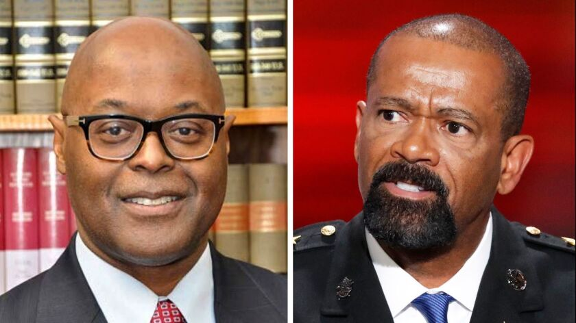 Milwaukee County Sheriff Earnell Lucas, left, has changed some policies of the former sheriff, David Clarke, who was a strong supporter of President Trump.