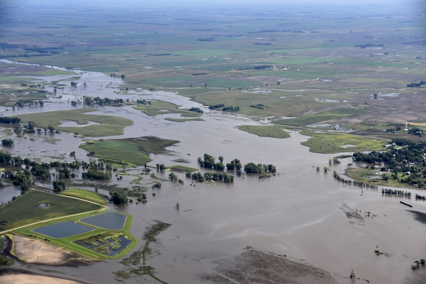 This Saturday, Sept. 14, 2019 photo provided by the South Dakota Civil Air Patrol shows an aerial view of the flooding in Spencer, S.D. Flooding from torrential rain that's soaked much of southeastern South Dakota has closed schools for a second day, submerged city streets and caused some to evacuate their homes. (South Dakota Civil Air Patrol via AP)