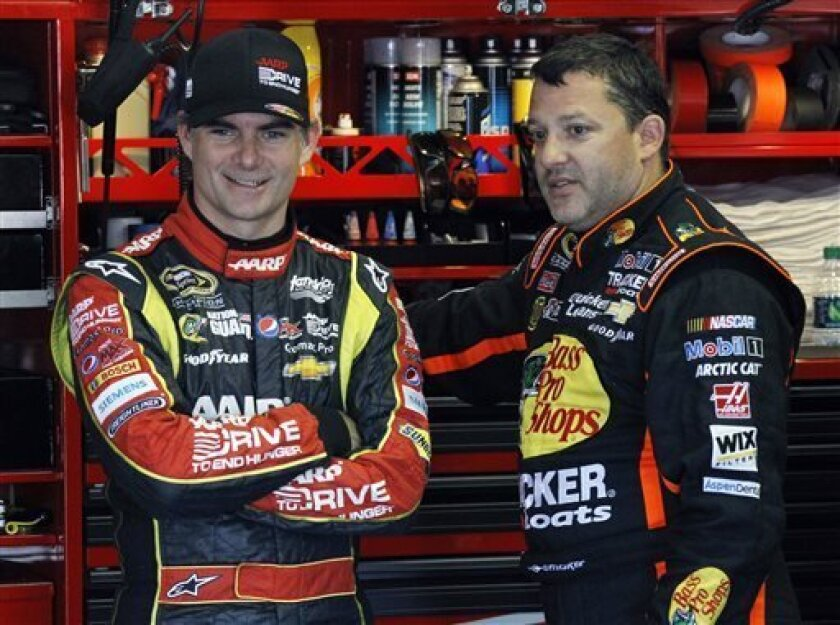 Drivers Jeff Gordon, left, and Tony Stewart talk in the garage during practice for Sunday's NASCAR Sprint Cup Series auto race, Friday Aug. 2, 2013, in Long Pond, Pa. (AP Photo/Russ Hamilton Sr.)