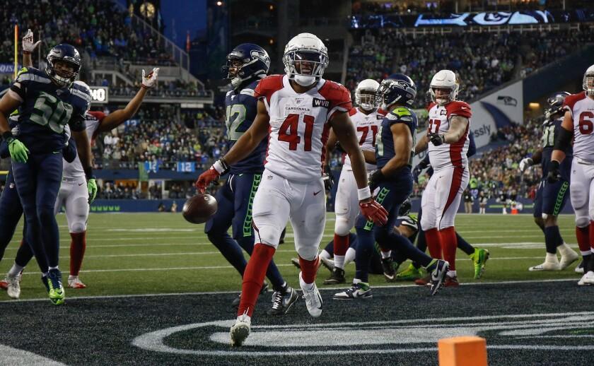 Arizona Cardinals running back Kenyan Drake celebrates after scoring a touchdown.