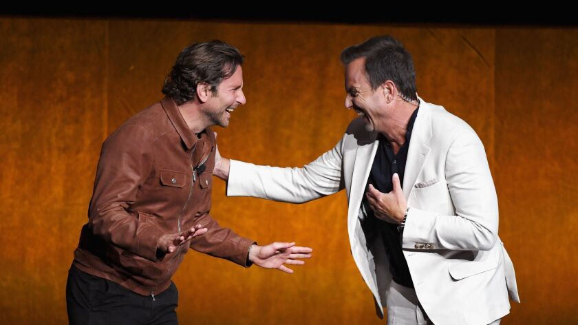 """Bradley Cooper and Will Arnett present the trailer for the Warner Bros. movie """"A Star Is Born"""" at CinemaCon in Las Vegas."""