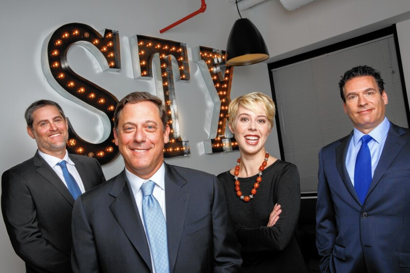 """STX Entertainment executives, from left: Domestic Distribution President Kevin Grayson, Motion Picture Group Chairman Adam Fogelson, President Sophie Watts and Chief Content Officer Oren Aviv. Watts has stepped down to """"focus on new business opportunities,"""" the company says."""