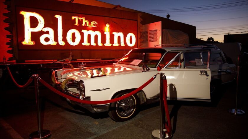 The 1964 Pontiac Bonneville station wagon owned by Nudie Cohn, on loan to the Valley Relics Museum, sits in front of the Palomino neon sign in 2018.