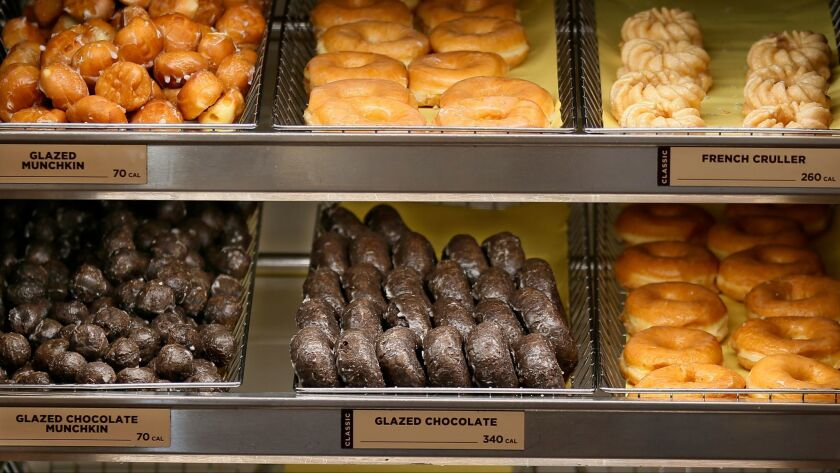 This Thursday, July 28, 2016, photo shows donuts for sale at a Dunkin' Donuts in Edmond, Okla. Dunki