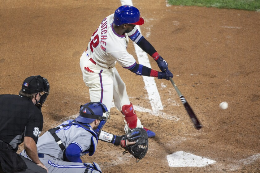 Philadelphia Phillies Andrew McCutchen (22) hits an RBI single during the fifth inning of a baseball game against the Toronto Blue Jays, Saturday, Sept. 19, 2020, in Philadelphia. (AP Photo/Laurence Kesterson)