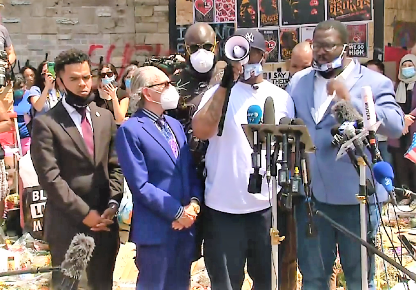 At the makeshift memorial in Minneapolis for his brother George Floyd, Terrence Floyd gives an impassioned speach to protestors urging peace. Rev. Shane Harris, of San Diego, stands on the far left.