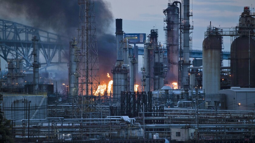 Flames and smoke emerge from the Philadelphia Energy Solutions Refining Complex in Philadelphia, Fri