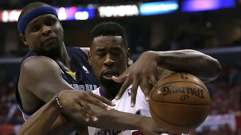 LOS ANGELES, TUESDAY, APRIL 30, 2013 - Grizzlies defender Zach Randolph knocks the ball loose from C