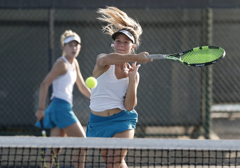 Reece Kenerson scores at the net as Corona del Mar doubles partner Jane Paulsen looks on against Huntington Beach in the semifinals of the CIF Southern Section Division 1 playoffs on Wednesday in Newport Beach.