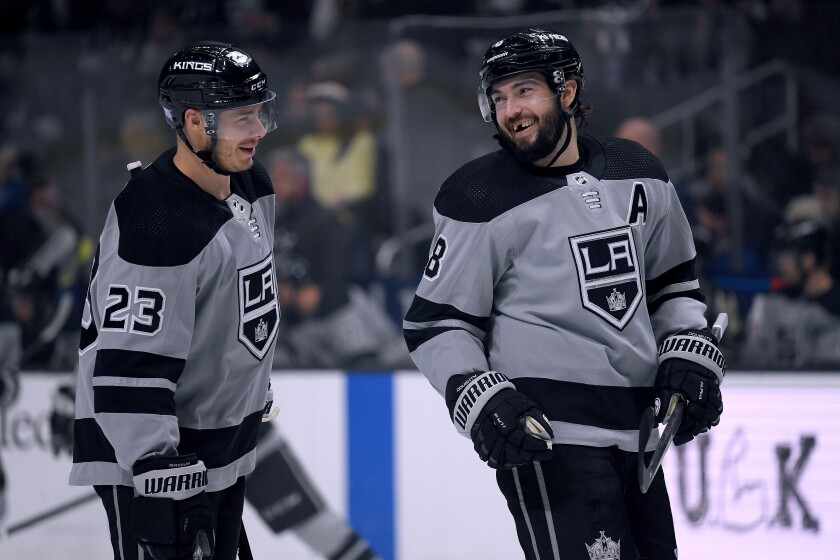 The Kings' Drew Doughty, right, and Dustin Brown share a laugh before a game Nov. 30, 2019.