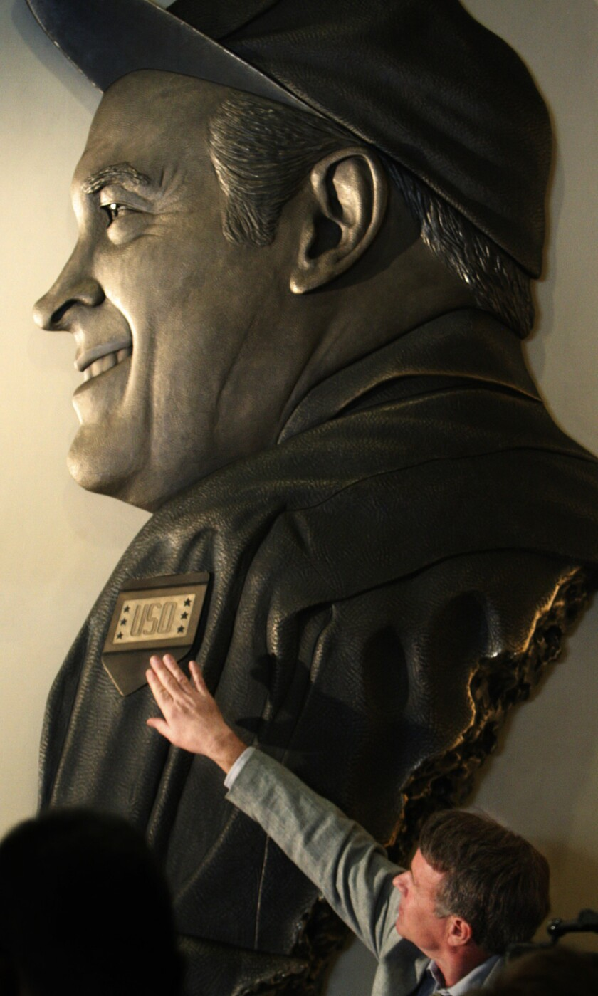 Sculptor Don F. Wiegand unveils a bronze likeness of comic legend Bob Hope at the airport that bore his name in 2010.