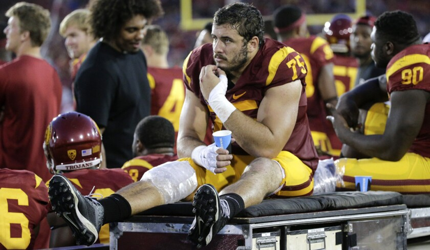 Former USC offensive lineman Max Tuerk watches from the sideline against Washington.