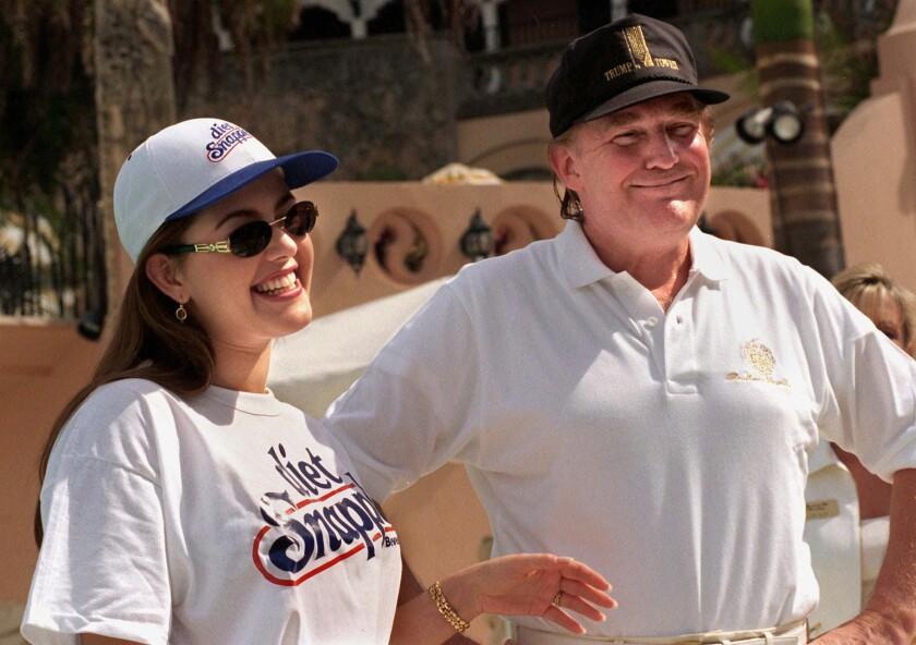 Miss Universe Alicia Machado, left, and Donald Trump chat at his Mar-a-Lago club in Palm Beach, Fla., on Feb. 15, 1997.