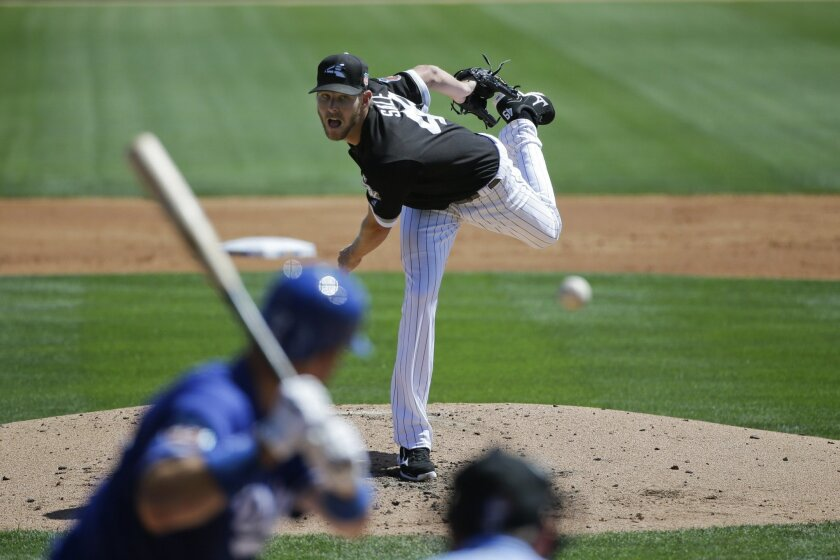 Chicago White Sox starting pitcher Chris Sale throws against the Los Angeles Dodgers during the second inning of a spring training baseball game Saturday, March 19, 2016, in Phoenix. (AP Photo/Jae C. Hong)