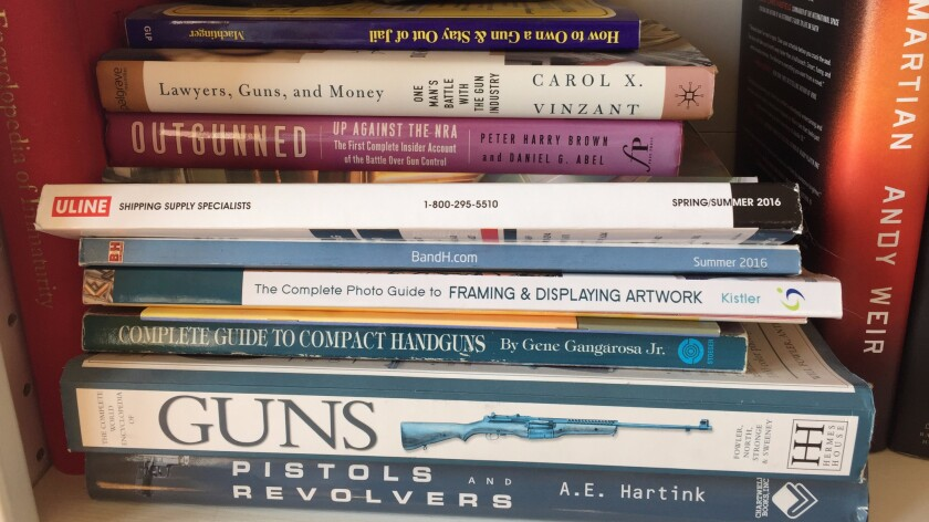 Books about guns on the shelves of Richard Ruggieri's home office.